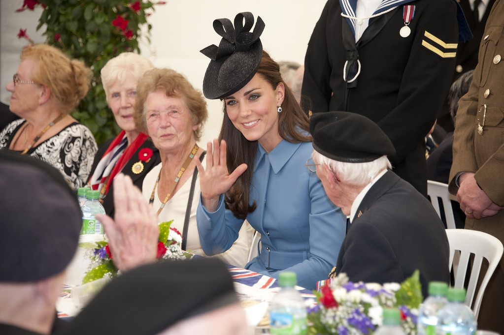 Description of . Catherine, Duchess of Cambridge meets veterans for tea before attending the Commemoration of the 70th anniversary of the Normandy Landings at Gold Beach on June 6, 2014 in Arromanches, France.  (Photo by Jamie Wiseman - Pool/Getty Images)