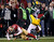Green Bay Packers Randall Cobb (C) is tackled by San Francisco 49ers Perrish Cox (L) next to Packers M.D. Jennings (R) in the second quarter during their NFL NFC Divisional playoff football game in San Francisco, California, January 12, 2013.  REUTERS/Robert Galbraith