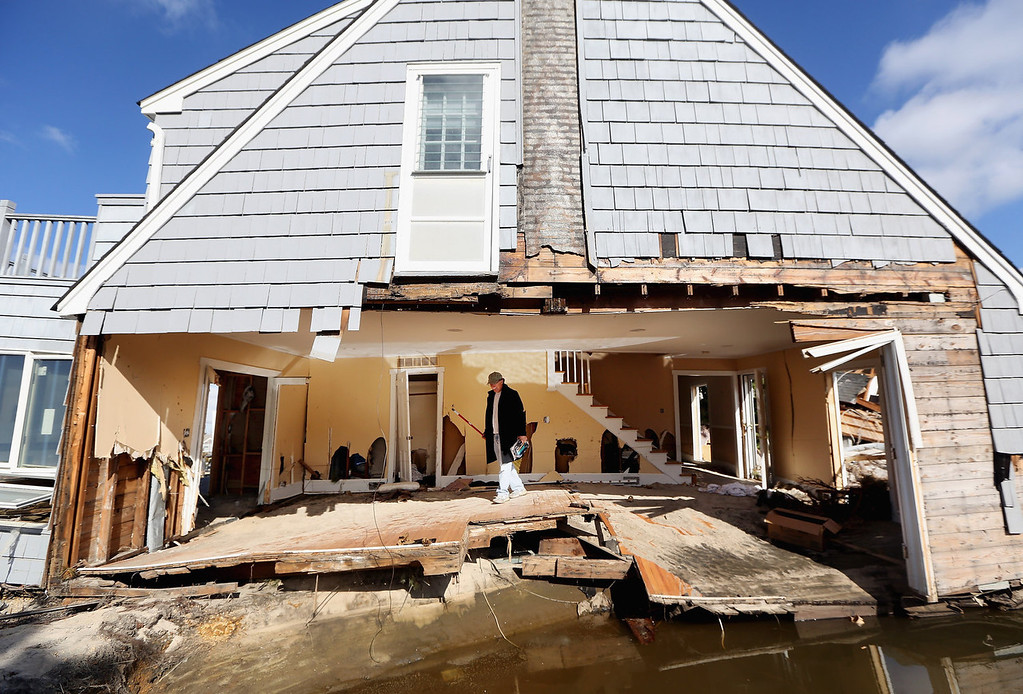 . Steven Lawit recovers items from his destroyed home on November 21, 2012 in Mantoloking, New Jersey. Mantoloking was one of the hardest hit areas by Superstorm Sandy.  (Photo by Mario Tama/Getty Images)