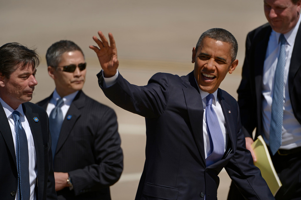 Description of . AURORA, CO- APRIL 3: President Barack Obama waves good by to the invited guests at Buckley Air Force base after  arriving  in Aurora, CO aboard Air Force One at Buckley Air Force Base in Aurora, CO on April 3, 2013. The president traveled to Colorado to meet with local law enforcement officials and community leaders to discuss the new gun control measures that the state has put in place including loopholes in the back round check system. (Photo By Helen H. Richardson/ The Denver Post)