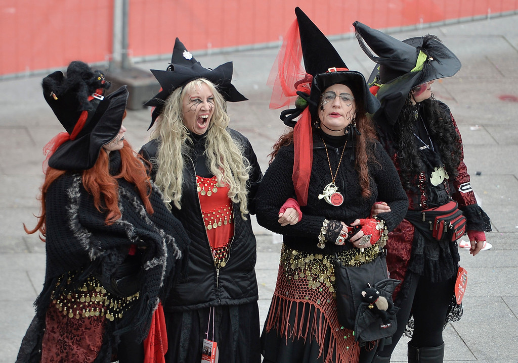 "Description of . Four women are dressed us as witches when tens of thousands of revelers dressed in carnival costumes celebrate the start of the street-carnival on the so called ""Old Women\'s Day\"" in the party capital Cologne, Germany, Thursday, Feb. 27, 2014. (AP Photo/Martin Meissner)"
