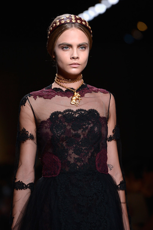 Description of . Cara Delevingne walks the runway during Valentino  show as part of the Paris Fashion Week Womenswear  Spring/Summer 2014 at Espace Ephemere Tuileries on October 1, 2013 in Paris, France.  (Photo by Pascal Le Segretain/Getty Images)