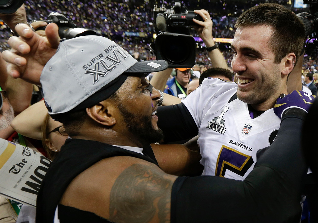 Description of . Baltimore Ravens linebacker Ray Lewis, left, and quarterback Joe Flacco celebrate their 34-31 win against the San Francisco 49ers in the NFL Super Bowl XLVII football game, Sunday, Feb. 3, 2013, in New Orleans. (AP Photo/Julio Cortez)