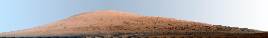 Description of . FILE - This composite image released by NASA shows a panoramic view of Mount Sharp, made from dozens of photos by NASA's Curiosity rover. (AP Photo/NASA)