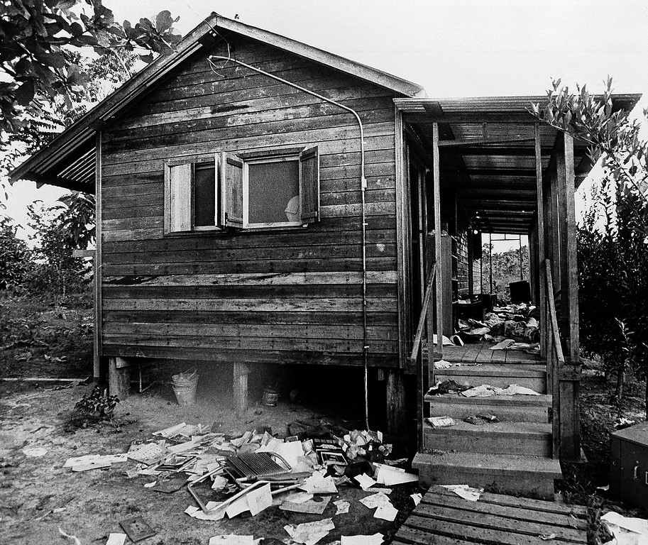 Description of . The home of Rev. Jim Jones, on Nov. 26, 1978, in Jonestown, Guyana. Outside lay scattered letters and papers from his files. Jones led a mass suicide of his religious cult that resulted in more than 900 deaths claiming they would be transported to another planet where they would live in peace in a new eden avoiding the nuclear fire that would engulf the earth. (AP Photo/Val Mazzenga)