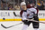 Colorado Avalanche defenseman Stefan Elliott passes the puck during the first period of their NHL hockey game against the Los Angeles Kings, Saturday, Feb. 23, 2013, in Los Angeles. (AP Photo/Mark J. Terrill)
