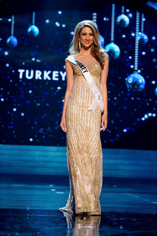 Description of . Miss Turkey 2012 Cagil Ozge Ozkul competes in an evening gown of her choice during the Evening Gown Competition of the 2012 Miss Universe Presentation Show in Las Vegas, Nevada, December 13, 2012. The Miss Universe 2012 pageant will be held on December 19 at the Planet Hollywood Resort and Casino in Las Vegas. REUTERS/Darren Decker/Miss Universe Organization L.P/Handout