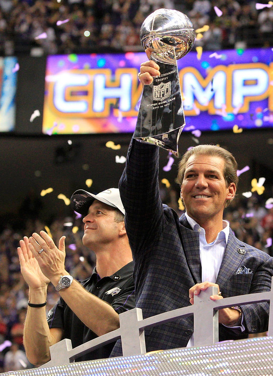 Description of . Baltimore Ravens head coach John Harbaugh (L) celebrates as team owner Steve Bisciotti holds up the Vince Lombardi Trophy after defeating the San Francisco 49ers in the NFL Super Bowl XLVII football game in New Orleans, Louisiana, February 3, 2013. REUTERS/Sean Gardner