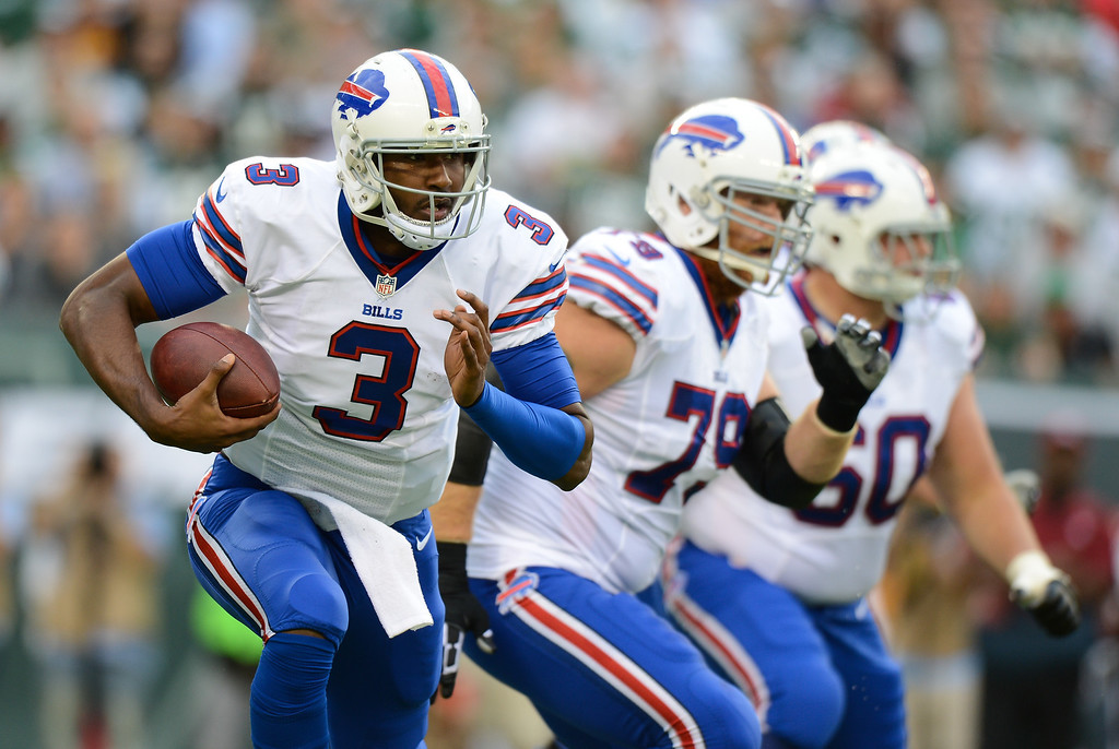 Description of . Quarterback EJ Manuel #3 of the Buffalo Bills runs the ball in the 1st half of the Jets game against the Buffalo Bills at MetLife Stadium on September 22, 2013 in East Rutherford, New Jersey. (Photo by Ron Antonelli/Getty Images)