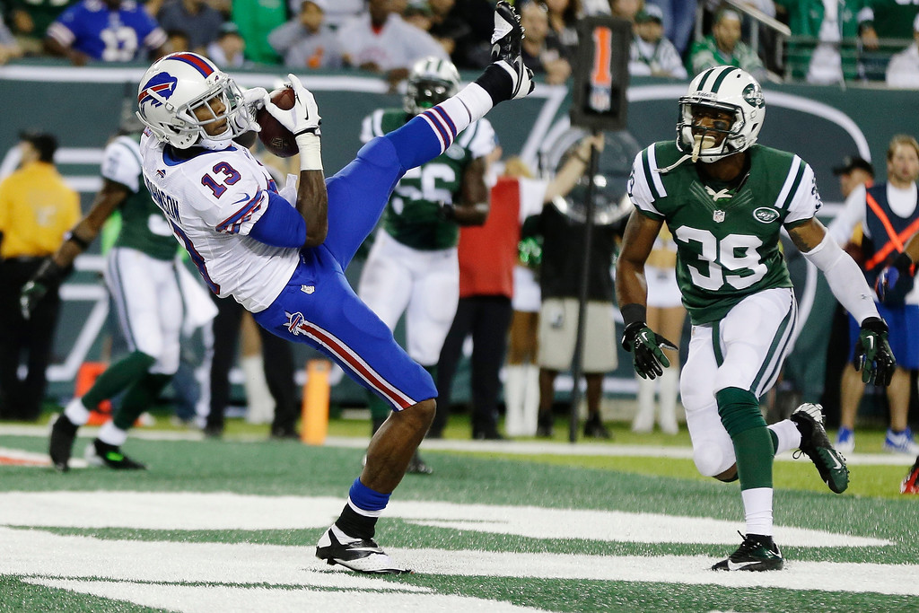 Description of . Buffalo Bills wide receiver Stevie Johnson (13) catches a two-point conversion during the second half of an NFL football game against the New York Jets Sunday, Sept. 22, 2013, in East Rutherford, N.J. (AP Photo/Seth Wenig)