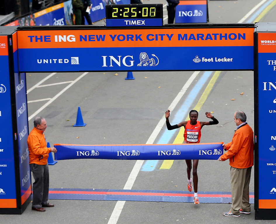 Description of . Priscah Jeptoo of Kenya crosses the finish line in Central Park to win the 2013 ING New York City Marathon on November 3, 2013 in New York City.  (Photo by Elsa/Getty Images)