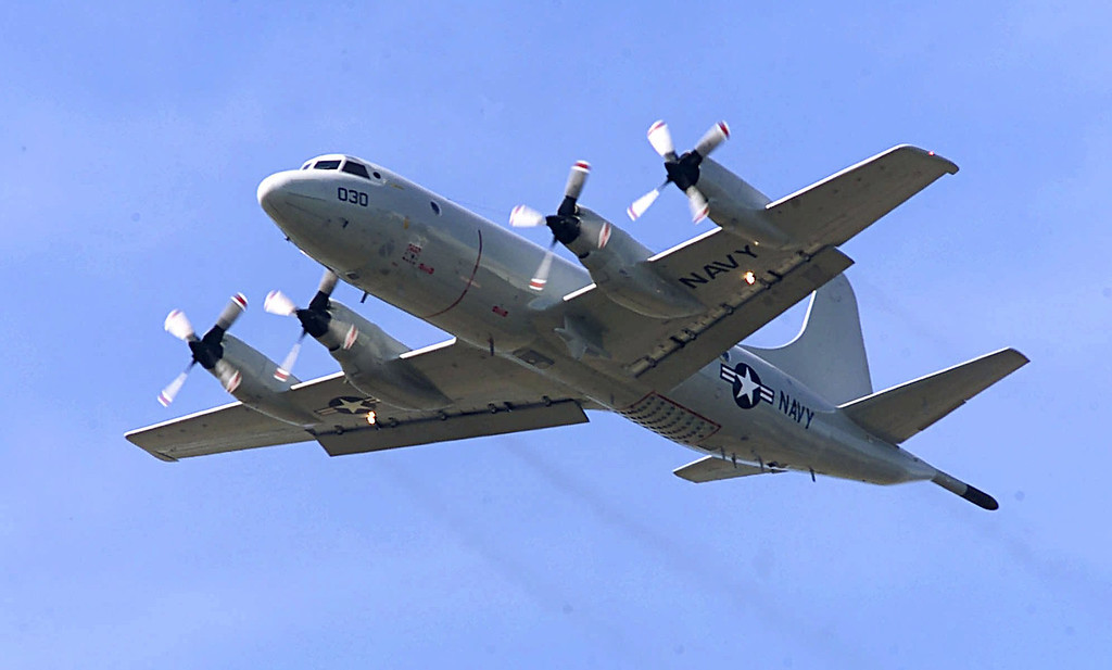 Description of . In this April 4, 2001 file photo, P-3C Orion practices touch-and-go landings at Whidbey Island Naval Air Station near Oak Harbor, Wash. The similar type of the P-3 Orion, favored by the Australian and New Zealand defense forces, is used in the search for the Malaysia Airlines Flight 370 which went missing on March 8, 2014, off the west coast of Australia. Because the search area is so remote, itís an eight-hour round trip, leaving the planes just two or three hours to search. (AP Photo/Stevan Morgain, File)