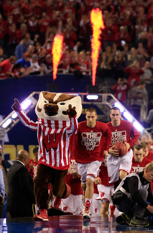 Description of . ARLINGTON, TX - APRIL 05: The Wisconsin Badgers take the floor before the NCAA Men's Final Four Semifinal against the Kentucky Wildcats at AT&T Stadium on April 5, 2014 in Arlington, Texas.  (Photo by Jamie Squire/Getty Images)