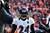 Baltimore Ravens cornerback Corey Graham (24) returns to the sidelines after scoring a touchdown off an interception int eh first quarter. The Denver Broncos vs Baltimore Ravens AFC Divisional playoff game at Sports Authority Field Saturday January 12, 2013. (Photo by AAron  Ontiveroz,/The Denver Post)