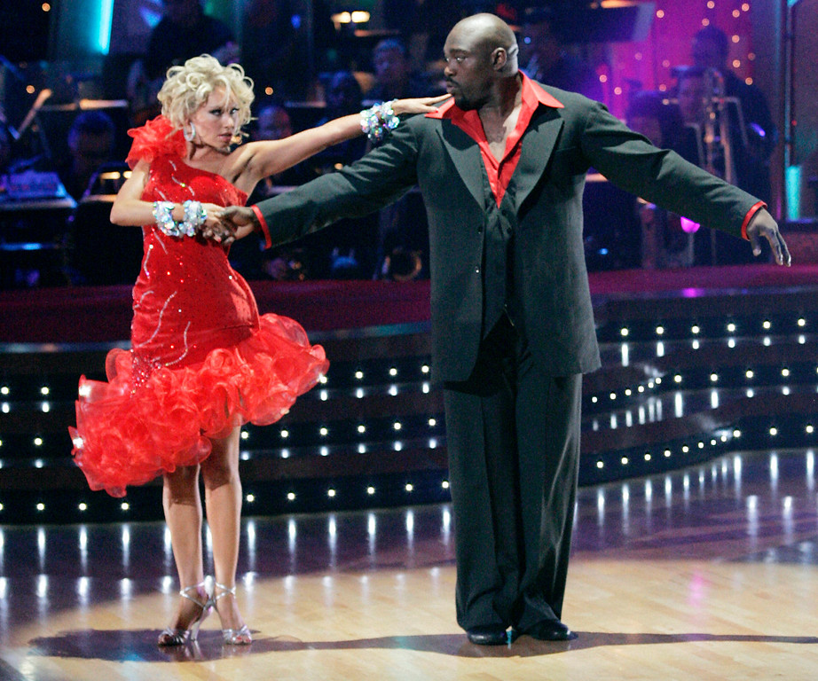 Description of . In this image released by ABC, Warren Sapp and his partner Kym Johnson perform on