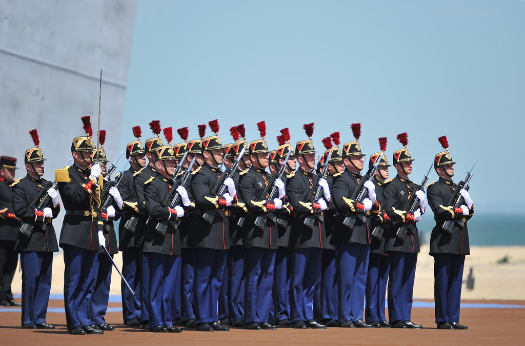 Description of . Members of the French Republican guard stand at attention to an international D-Day commemoration ceremony on the beach of Ouistreham, Normandy, on June 6, 2014, marking the 70th anniversary of the World War II Allied landings in Normandy. AFP PHOTO / GUILLAUME  SOUVANT/AFP/Getty Images