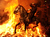 A man rides a horse through a bonfire on January 16, 2012 in the small village of San Bartolome de Pinares, Spain. In honor of San Anton, the patron saint of animals, horses are riden through the bonfires on the night before the official day of honoring animals in Spain.  (Photo by Jasper Juinen/Getty Images)
