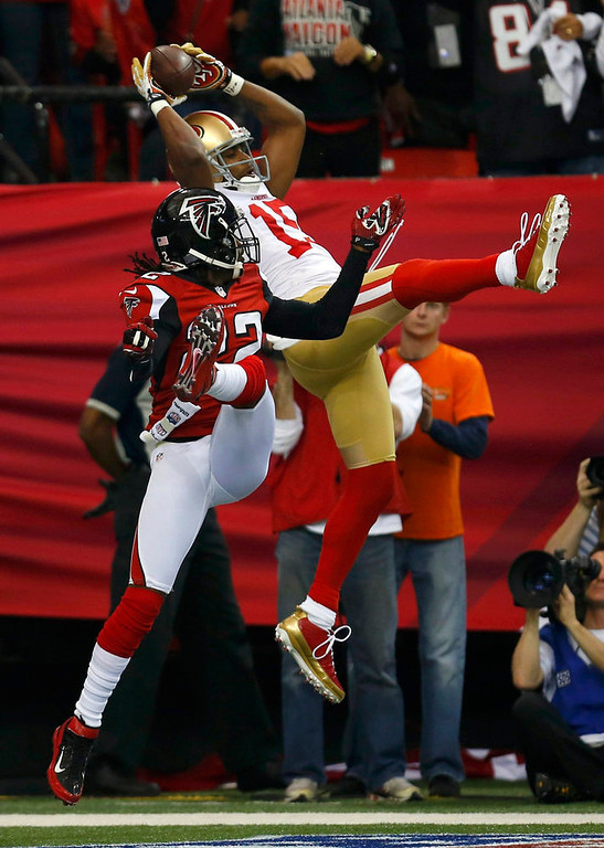 Description of . San Francisco 49ers Michael Crabtree (15) leaps to catch a touchdown pass in the end zone over Atlanta Falcons\' Asante Samuel (22) in the NFL NFC Championship football game in Atlanta, Georgia January 20, 2013. REUTERS/Jeff Haynes