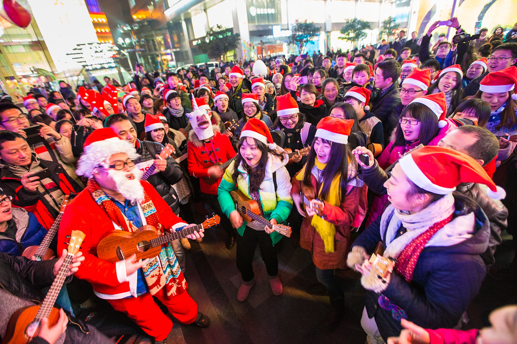 Description of . NANJING, CHINA - DECEMBER 24:  People dressed in Santa Claus costumes attend a celebration for the Christmas Eve at Xinjiekou on December 24, 2013 in Nanjing, China.  (Photo by ChinaFotoPress/Getty Images)