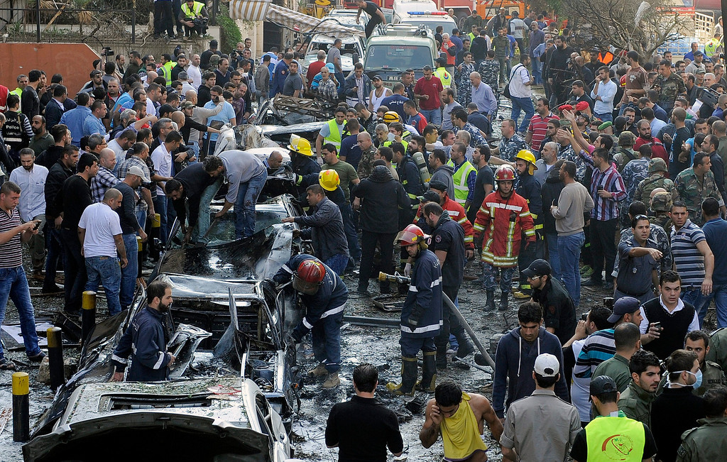 . Lebanese rescue teams and security forces inspect at the scene of a blast near the Iranian embassy in Beirut, Lebanon, 19 November 2013. Reports vary regarding fatalities but at least 15 people are believed to have been killed in south Beirut a stronghold of the Hezbollah militant movement.  EPA/WAEL HAMZEH