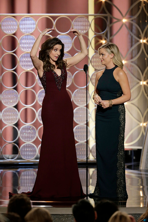 Description of . This image released by NBC shows hosts Tina Fey, left, and Amy Poehler during the 71st annual Golden Globe Awards at the Beverly Hilton Hotel on Sunday, Jan. 12, 2014, in Beverly Hills, Calif. (AP Photo/NBC, Paul Drinkwater)