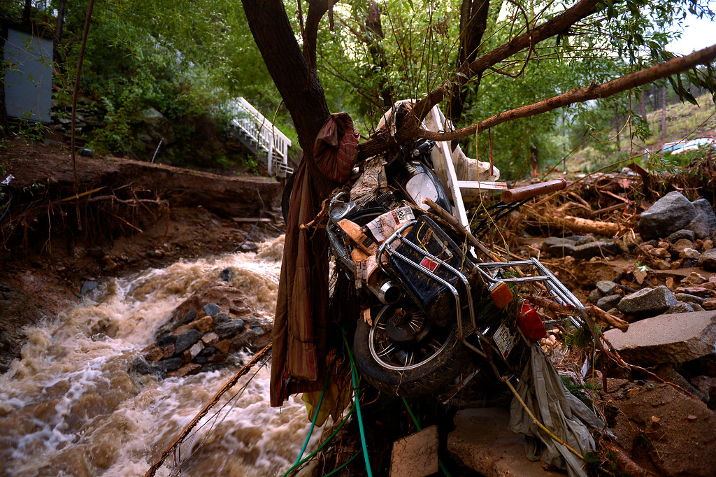 Description of . SALINA, CO. - September 13: A motorcycle is wrapped around a tree in Salina which was mostly washed away after heavy rains caused flash flooding and major damage September 13, 2013. (Photo By Joe Amon/The Denver Post)