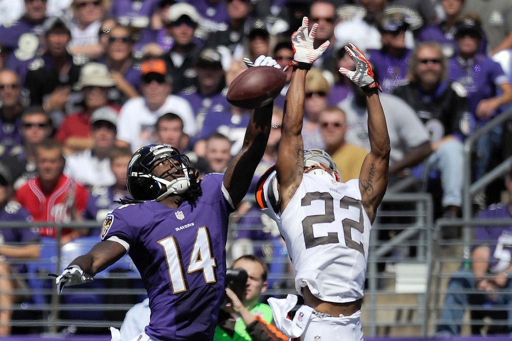 Description of . Baltimore Ravens wide receiver Marlon Brown (14) cannot hang on to a pass under pressure from Cleveland Browns cornerback Buster Skrine (22) during the first half of a NFL football game in Baltimore, Md., Sunday, Sept. 15, 2013. (AP Photo/Nick Wass)