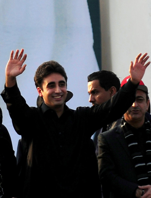 Description of . Bilawal Bhutto, son of assassinated former Pakistani premier Benazir Bhutto, and chairman of ruling Pakistan People's Party (PPP) waves to supporters outside the Bhutto family mausoleum in Garhi Khuda Bakhsh on December 27, 2012, on the fifth anniversary of the assassination of Benazir Bhutto. The son of Pakistan's slain former prime minister Benazir Bhutto launched his political career on the anniversary of his mother's death with an attack on the country's judiciary. More than 200,000 people gathered at the Bhutto family mausoleum in Garhi Khuda Bakhsh in the southern province of Sindh to pay their respects to Benazir and to hear Bilawal Bhutto Zardari make his first major public speech. AFP PHOTO/RIZWAN TABASSUM/AFP/Getty Images