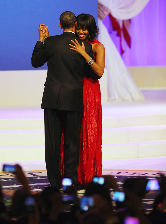 Description of . U.S. President Barack Obama and first lady Michelle Obama dance during the Commander-In-Chief's Inaugural Ball January 21, 2013 in Washington, DC. Obama was sworn in today for his second term in a public ceremonial swearing in..  (Photo by Joe Raedle/Getty Images)