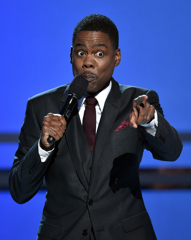 Description of . Host Chris Rock speaks onstage during the BET AWARDS '14 at Nokia Theatre L.A. LIVE on June 29, 2014 in Los Angeles, California.  (Photo by Kevin Winter/Getty Images for BET)