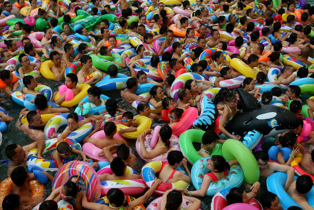 Description of . This picture taken on July 27, 2013 shows people trying to cool off at a water park in Suining, southwest China's Sichuan province, as a heatwave hit several provinces in China.   STR/AFP/Getty Images