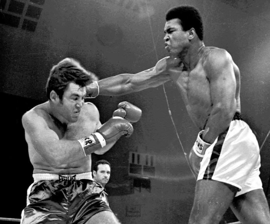 Description of . Muhammad Ali hits a hard right to Jerry Quarry during their fight Oct. 26, 1970, in Atlanta, Ga.  The fight was stopped after the third round and Ali was declared the winner. Quarry, a popular heavyweight who fought Ali and Floyd Patterson then eventually lapsed into a punch-drunk fog, died Sunday, Jan. 3, 1999 in Templeton, Calif. after being taken off life support. He was 53. (AP Photo/File)