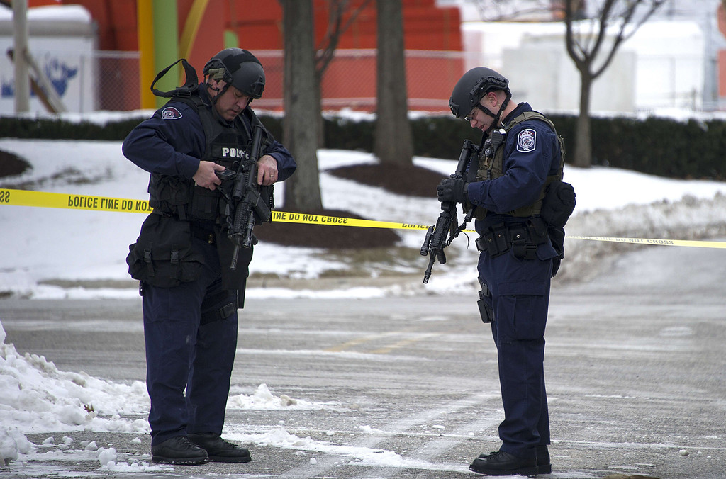 Description of . Maryland State Police patrol the Columbia Mall after a fatal shooting on January 25, 2014, in Columbia, Maryland.     AFP PHOTO / Jim WATSON/AFP/Getty Images
