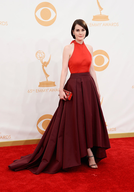 Description of . Actress Michelle Dockery arrives at the 65th Annual Primetime Emmy Awards held at Nokia Theatre L.A. Live on September 22, 2013 in Los Angeles, California.  (Photo by Frazer Harrison/Getty Images)
