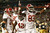 Alabama Crimson Tide's Eddie Lacy (C) celebrates with teammates Kevin Norwood (R) and Jerrod Bierbower (L) after scoring a touchdown against the Notre Dame Fighting Irish in the first quarter of their NCAA BCS National Championship college football game in Miami, Florida January 7, 2013. REUTERS/Jeff Haynes