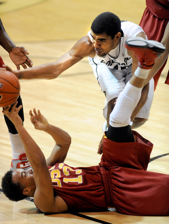 Description of . Chass Bryan of USC, bottom and Josh Scott of Colorado try to control a loose ball during the second half of their Jan. 10, 2013 game in Boulder. (AP Photo/Daily Camera, Cliff Grassmick)