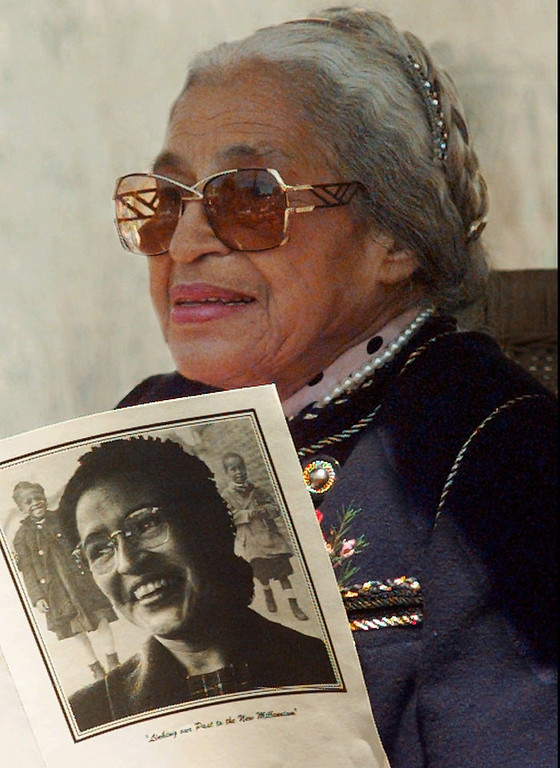 Description of . Rosa Parks, 84, holds a program from the Rosa Park Elementary School dedication during the ceremony in this Thursday April 24, 1997 file photo, in San Francisco. Parks, the black seamstress who helped launch the civil rights movement by refusing to give up her seat to a white man on a bus in Alabama's capital, will be inducted in 2008 into the state Women's Hall of Fame. (AP Photo/Lacy Atkins)