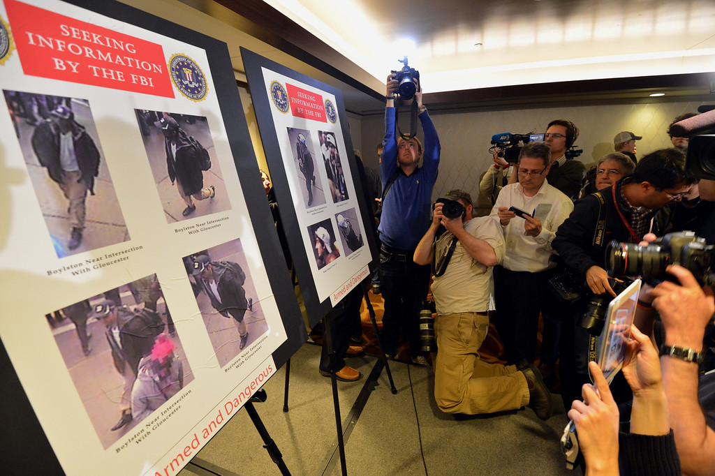 Description of . Photographs of two suspects wanted in the Boston Marathon bombings released by the FBI are shown at a press conference April 18, 2013 in Boston, Massachusetts.  AFP PHOTO/Stan  HONDA/AFP/Getty Images