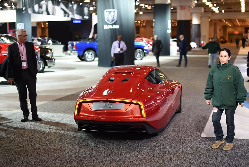 Description of . A Volkswagen XL1 car is displayed during the second press preview day at the 2014 New York International Auto Show  April 17, 2014  in New York at the Jacob Javits Center. AFP PHOTO / Timothy A. CLARY/AFP/Getty Images
