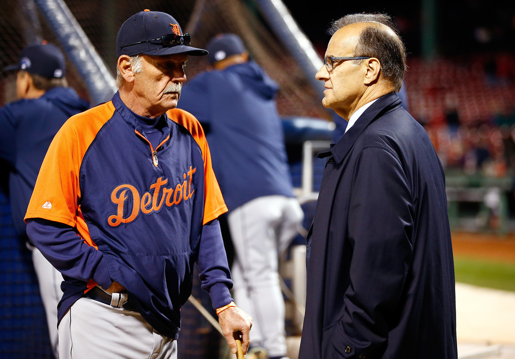Description of . Manager Jim Leyland #10 of the Detroit Tigers speaks with Joe Torre before Game Two of the American League Championship Series against the Boston Red Sox at Fenway Park on October 13, 2013 in Boston, Massachusetts.  (Photo by Jared Wickerham/Getty Images)