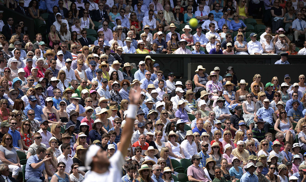 Description of . Spectators watch in the crowd as Argentina\'s Juan Martin Del Potro plays Serbia\'s Novak Djokovic in the first men\'s singles semi-final match on day eleven of the 2013 Wimbledon Championships tennis tournament at the All England Club in Wimbledon, southwest London, on July 5, 2013. ADRIAN DENNIS/AFP/Getty Images