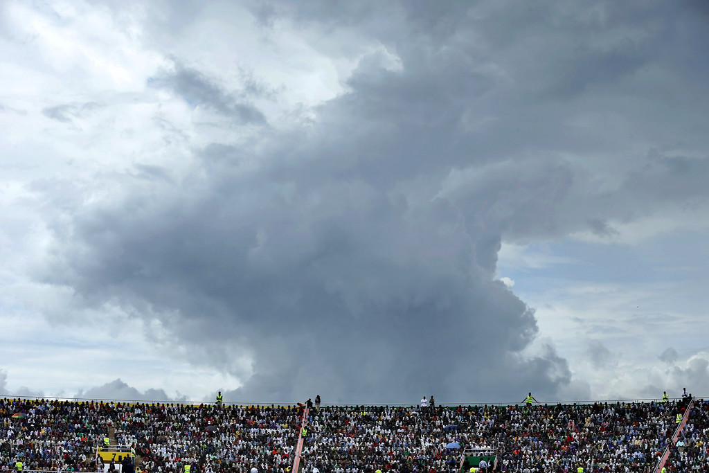 Description of . The sky threatens rain as tens of thousands of people gather to commemorate the 20th anniversary the 1994 genocide at Amahoro Stadium April 7, 2014 in Kigali, Rwanda.  (Photo by Chip Somodevilla/Getty Images)