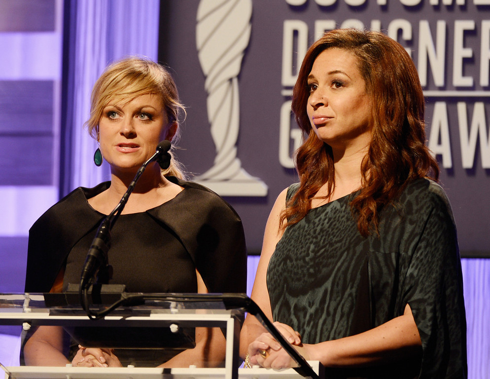 Description of . Actresses Amy Poehler and Maya Rudolph speak onstage during the 15th Annual Costume Designers Guild Awards with presenting sponsor Lacoste at The Beverly Hilton Hotel on February 19, 2013 in Beverly Hills, California.  (Photo by Frazer Harrison/Getty Images for CDG)
