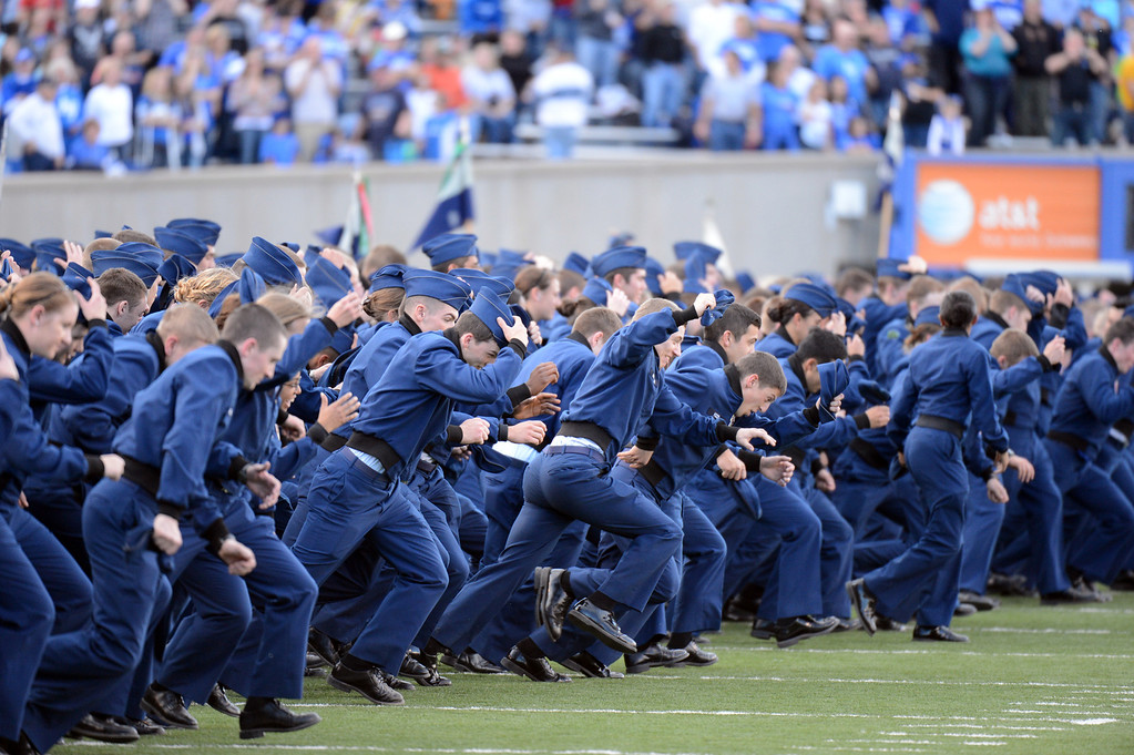 Description of . Air Force cadets cheer the team during the game against New Mexico at Falcon Stadium. Colorado Springs. Saturday, October 20, 2012. Hyoung Chang, The Denver Post
