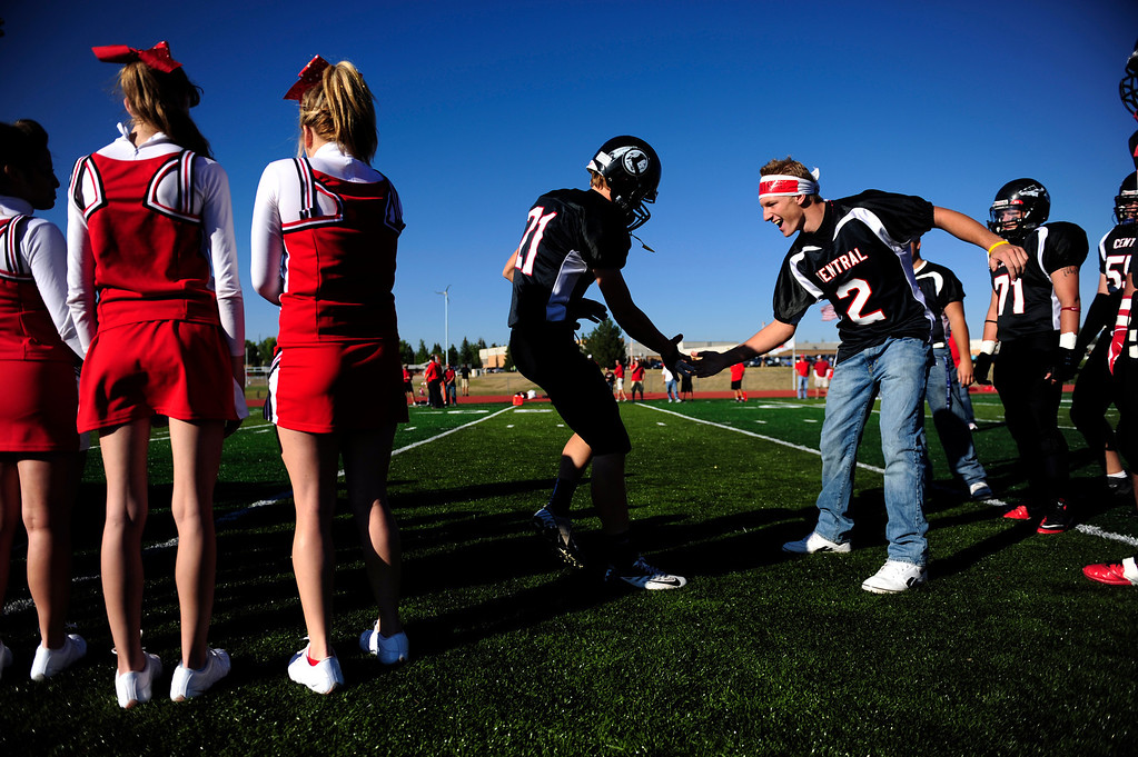 Description of . Cheyenne Central's Greg Ashley (left) is high fived by teammate Rhett Muchmore before playing Cheyenne East. East won 42-28 at Central's Riske Field on Friday, September 14, 2012. AAron Ontiveroz, The Denver Post