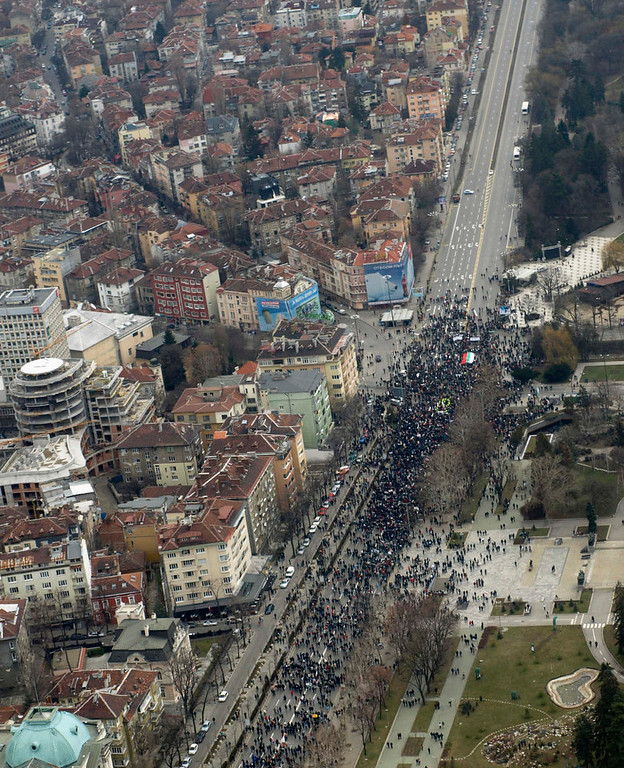. An aerial view shows demonstrators as they march during a protest against high utility bills and monopolies in the energy sector in Sofia February 24, 2013. Tens of thousands of people marched in cities across Bulgaria on Sunday, demanding an end to high utility bills and new voting rules after the government was toppled last week. Public anger with power monopolies in the European Union\'s poorest member forced right-of-centre Prime Minister Boiko Borisov\'s cabinet to resign and has put the country on track for an early election by May. REUTERS/Ivan Kalev/Sofia Photo Agency