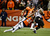 Baltimore Ravens running back Ray Rice (27) is tackled by Denver Broncos cornerback Chris Harris (25) in the fourth quarter. The Denver Broncos vs Baltimore Ravens AFC Divisional playoff game at Sports Authority Field Saturday January 12, 2013. (Photo by AAron  Ontiveroz,/The Denver Post)