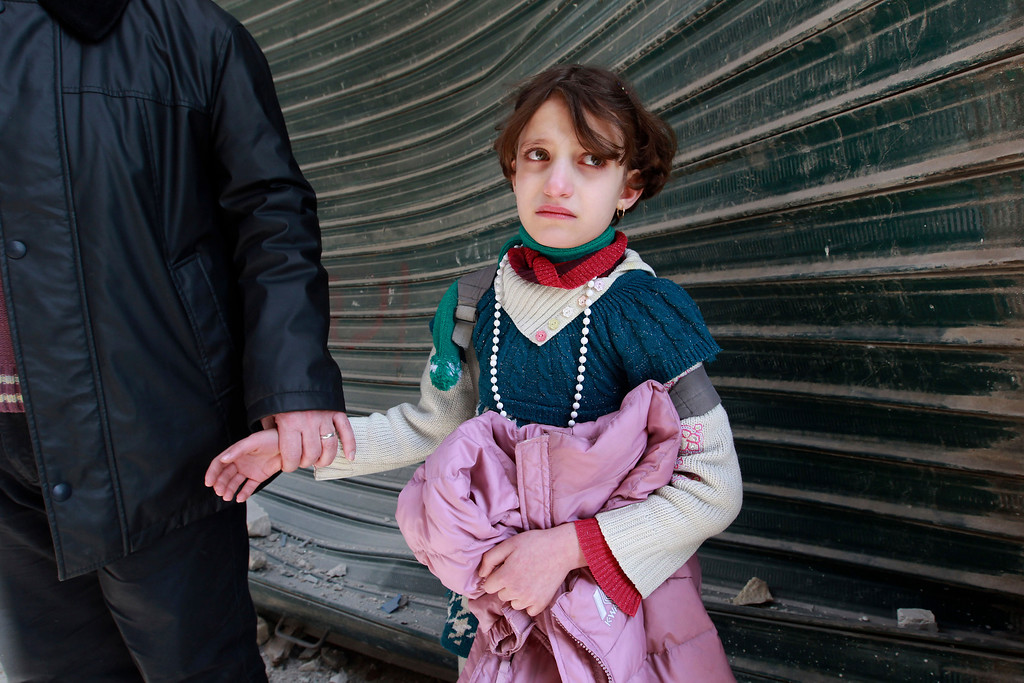 Description of . A girl who returned from school cries upon seeing her house destroyed after a jet missile hit the al-Myassar neighborhood of Aleppo February 20, 2013.  REUTERS/Muzaffar Salman