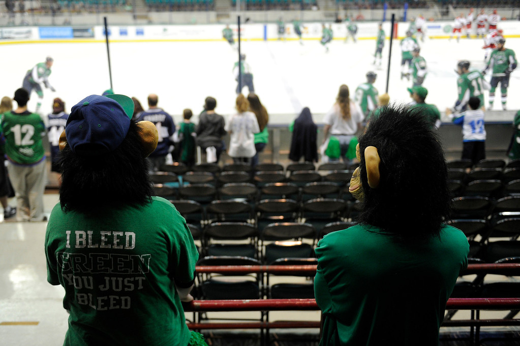 Description of . DENVER, CO - MAY 2: A pair of fans dressed as monkeys watch the Denver Cutthroats and Allen Americans warmup before the first period of game 1 of the Ray Miron Presidents Cup Finals at the Denver Coliseum in Denver, Colorado on May 2, 2014. (Photo by Seth McConnell/The Denver Post)