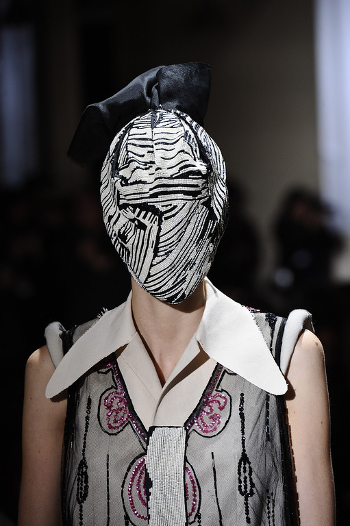Description of . A model wears a creation by fashion designer Martin Margiela as part of his Spring/Summer 2013 Haute Couture fashion collection, in Paris, Wednesday, Jan. 23, 2013. (AP Photo/Zacharie Scheurer)